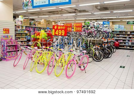 SHENZHEN, CHINA - JANUARY 22, 2015: Walmart shopping center interior. Wal-Mart Stores is an American multinational retail corporation that operates a chain of discount department and warehouse stores