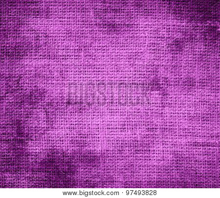 Grunge background of deep fuchsia burlap texture