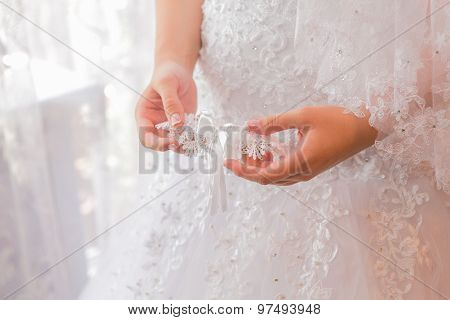 Bride's Garter In Woman's Hands.