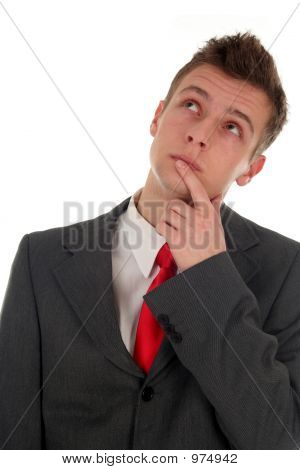 Portrait Of Thinking Businessman