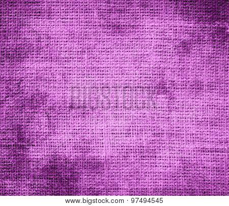 Grunge background of deep mauve burlap texture
