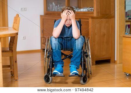 Disabled Boy In Wheelchair Is Sad