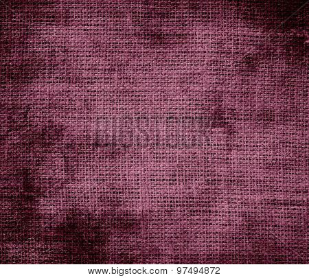 Grunge background of deep ruby burlap texture