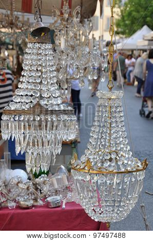 Old crystal lamps on antique market in Arezzo , Italy