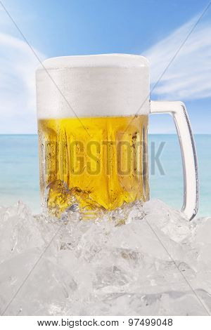 Cold Lager With Froth In The Glass At Beach