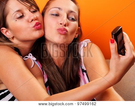Young Women Looking At A Cellphone