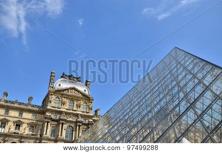 Paris, France - May 14, 2015: Glass Pyramid At Louvre Museum In Paris