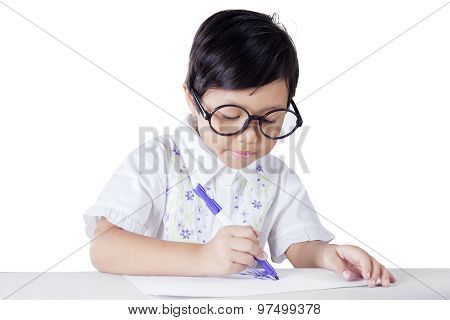 Cute Little Girl Drawing On The Paper