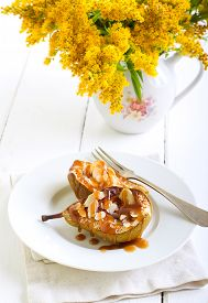 picture of toffee  - Toffee pears with almonds served on plate - JPG