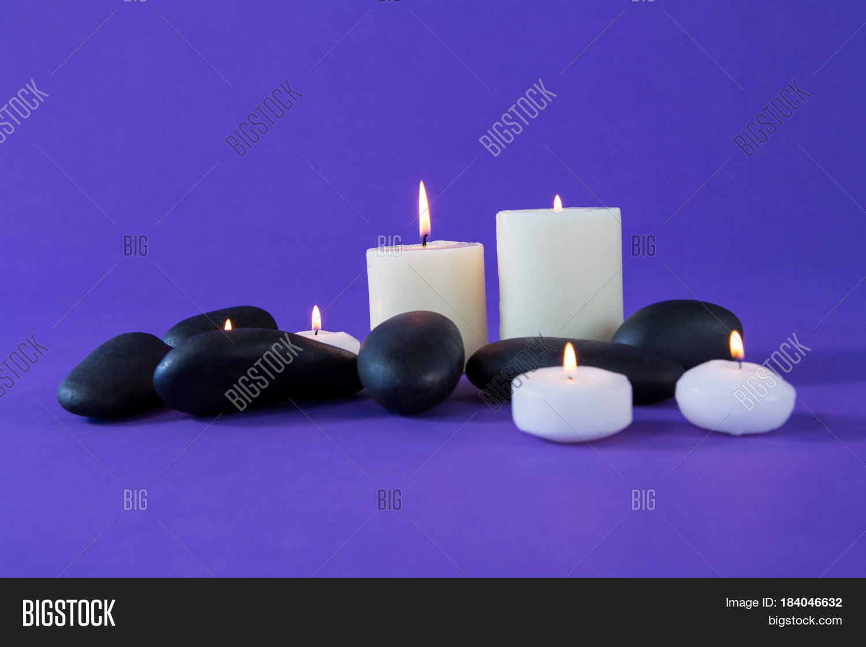 lit candles zen stones on purple image photo bigstock. Black Bedroom Furniture Sets. Home Design Ideas