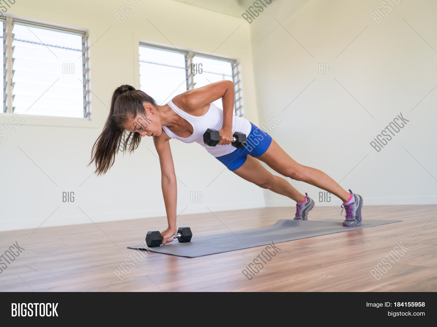 Fitness girl doing dumbbells plank image photo bigstock for Floor workout