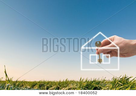 hand holding a house key