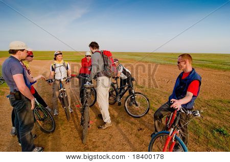 Mixed group of cyclists at sunset