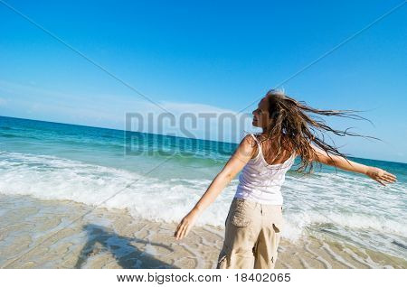woman running at the beach