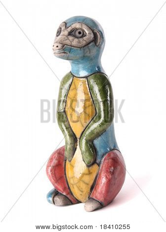 african meerkat statue isolated on white