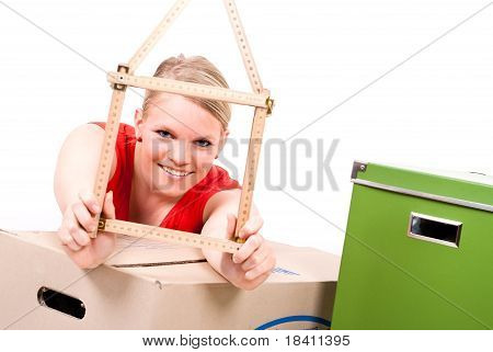 Young Woman With House Symbol Between Move Cardboards