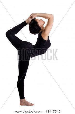 beauty woman in black stand in yoga Dancer Pose