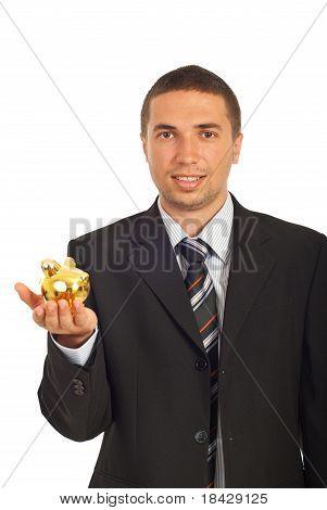 Business Man Holding Piggy Bank