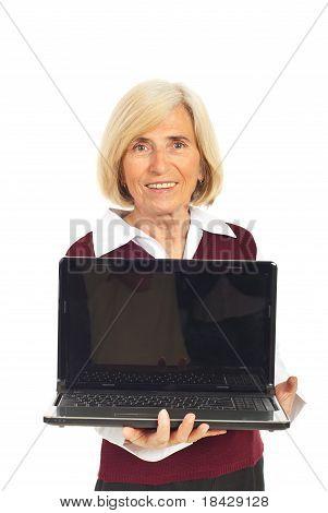 Smiling Senior Woman Holding Open Laptop