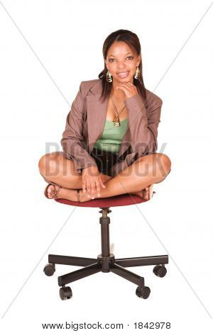 African Businesswoman On Office Chair