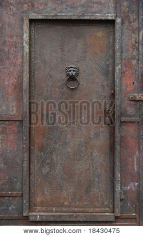 Old, rusty, heavy iron door.