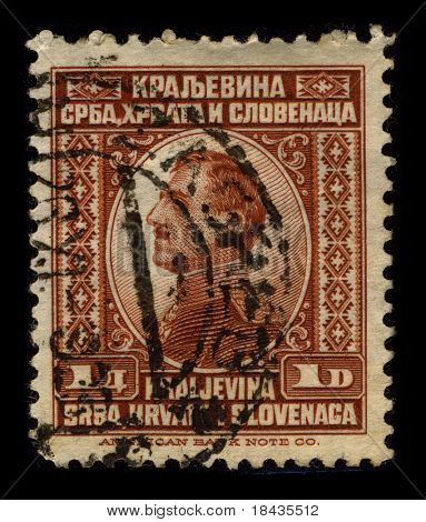 YUOGOSLAVIA -CIRCA 1920:A stamp printed in YUOGOSLAVIA shows image of Alexander I was the first king of the Kingdom of Yugoslavia as well as the last king of the Kingdom of Serbs, circa 1920.