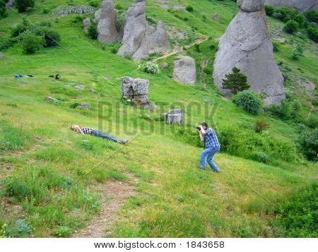 One Guy Make Photo Of Another At The Bottom Of Dimerzhi Mountain
