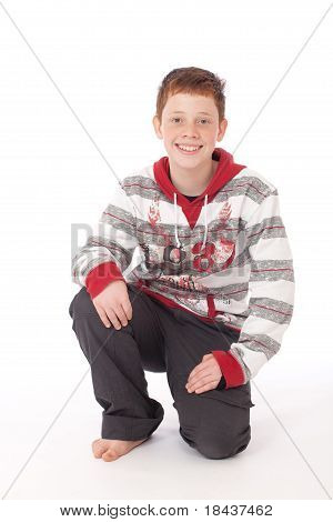 Teenager Kneeling on floor and smiling isolated on white