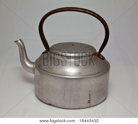 Old silver kettle with black handle used to boil water