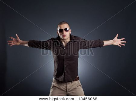 Stylish Young Man With His Arms Open