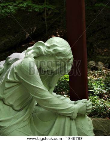 Woman Praying Religious Statue