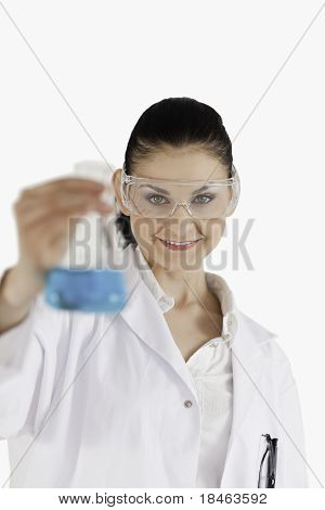 Dark-haired Scientist With Safety Glasses Holding A Blue Flask