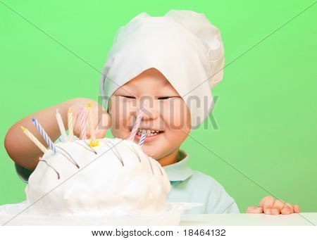Boy Putting Candles In Birthday Cake