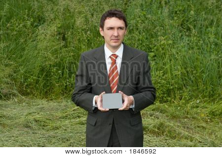 Businessman Holding Grey Card
