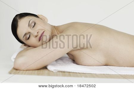 Dark-haired Woman Relaxing In A Spa Centre