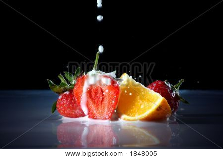 Milk Drop Into Fresh Fruit