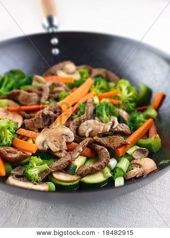 colorful stir fry in a wok