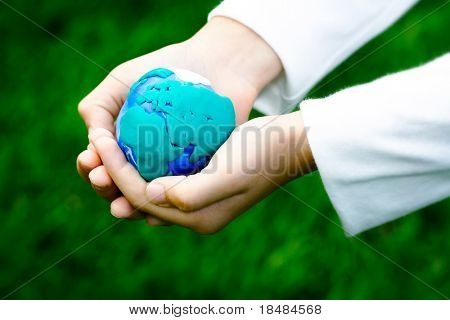 Plasticine earth in children's hand