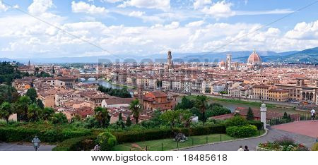 Florence cityscape and skyline with cloudscape background, Michelangelo park in foreground, Tuscany, Italy.