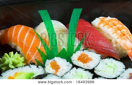 Closeup of a colorful mixture of sushi.