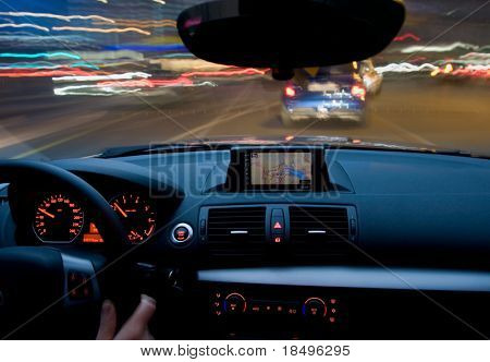 Inside of a car moving very fast, zooming motion