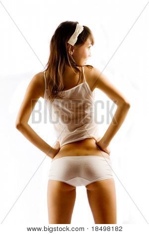 Thin model in wet, see through underwear on white background