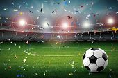 Soccer Ball With Soccer Stadium And Confetti Background poster
