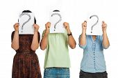 image of question-mark  - Three casual people standing in a line and holding questions marks isolated on white background - JPG