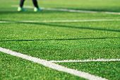 Artificial Green Grass With White Stripe Of Soccer Field poster