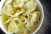 stock photo of wanton  - wonton soup shot from a overhead view looking straight down - JPG