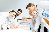 Постер, плакат: Doctors And Senior Patient