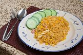 Close up of a plate of delicious spicy indonesian fried rice poster