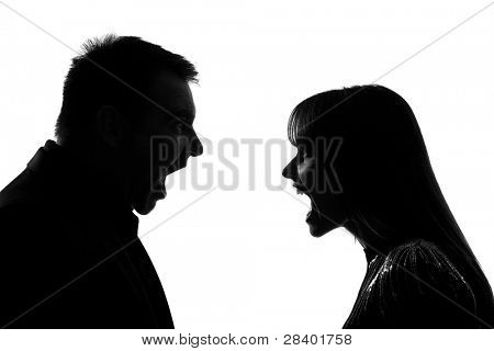 one caucasian couple man and woman face to face screaming shouting dipute in studio silhouette isolated on white background