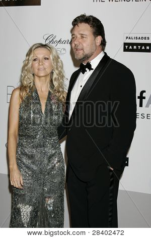 ANTIBES - MAY 20: Russell Crowe, wife Danielle Spencer at the AMFAR Cinema Against Aids Gala at the Hotel Du Cap on  May 20, 2010 in Antibes, France